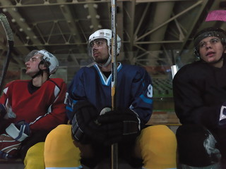 hockey players on bench