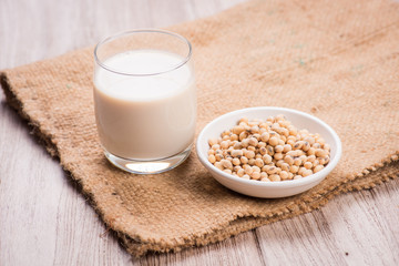 Soybeans and soy milk in a glass.