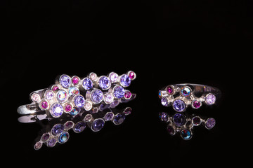 earring and ring with colorful gems