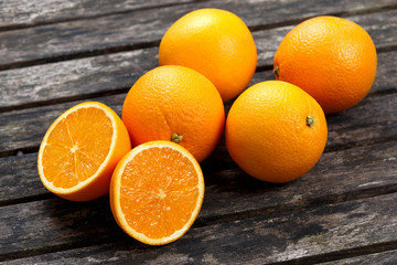 Beautiful Oranges on old wooden table. background, texture.