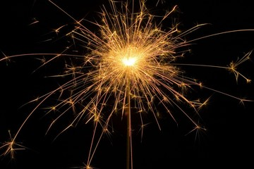 Detail view of a sparkler at night