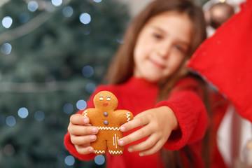 Nice girl holding ginger bread