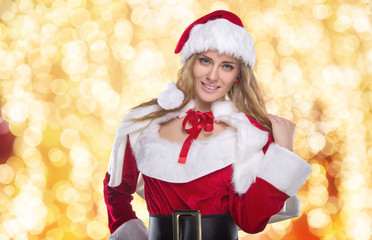 Beautiful young girl in a Christmas costume. New Year's holidays. Woman celebrating Christmas
