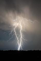 Foto op Plexiglas Zalm lightning and clouds in night landscape storm