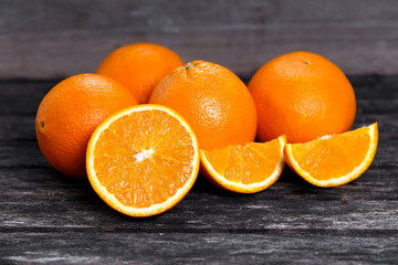 Beautiful Oranges Fruit Full and Sliced on old wooden table. rich with vitamins. background, texture
