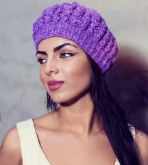 woman in purple knitted cap, portrait
