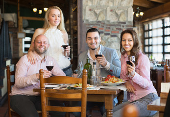 Adults having dinner in restaurant
