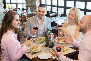 Young people enjoying food at tavern