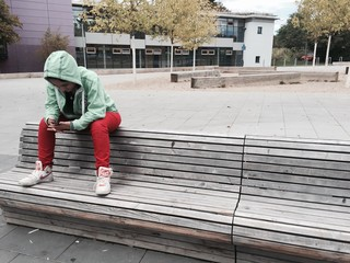 Girl chilling on bench