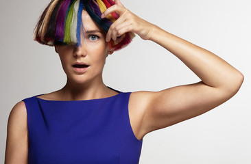 surprised women touching colored hair