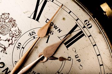 pointers of antique marine chronometer reaching twelve Fotoväggar