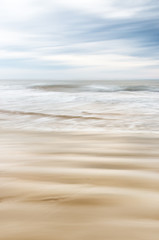 Fototapete - Sand and Water in Motion