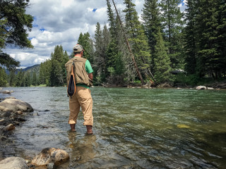 Spoed Fotobehang Vissen Fly fishing the Gallatin River