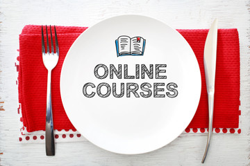 Online Courses concept on white plate