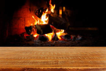 Wooden table over fireplace. Christmas holiday concept