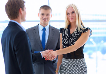 Shot of a businesswoman and a businessman shaking hands