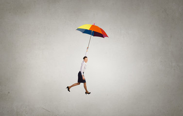 Woman fly on umbrella