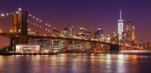 Brooklyn Bridge and Manhattan at night, New York City, USA.