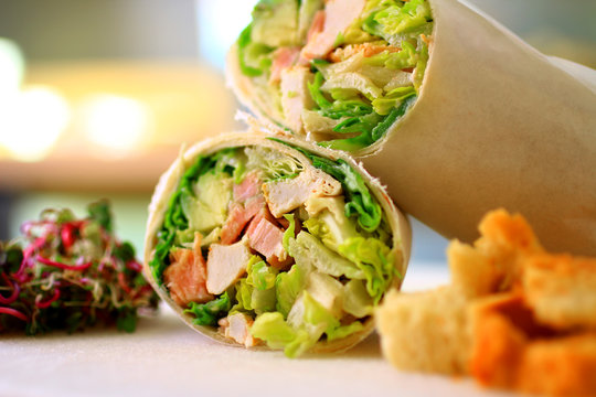 healthy wrap chicken and lettuce with salad and croutons on a side shot front on close-up and cropped landscape