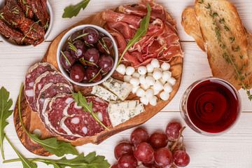 Wine snack set. Variety of cheese and meat, olives, grapes, arug