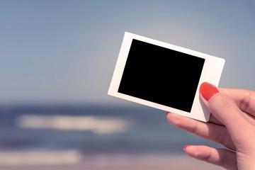 Retro Photo Of Girl Hand Holding Blank Card On Summer Beach
