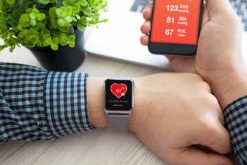 Man hands with watch and phone with app health