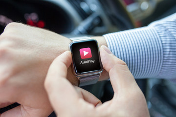 Man hand in the car watch and app auto play