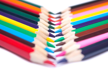 colored pencils on an isolated background