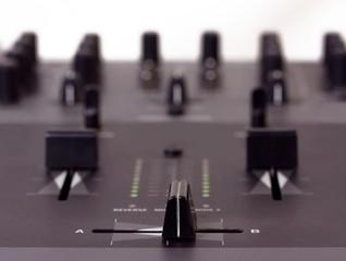 DJ mixer closeup shot