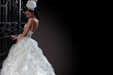 Beautiful brunette bride in black background. copy space.