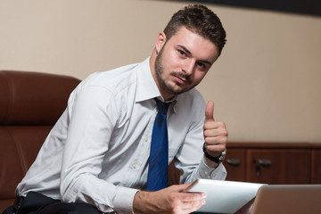 Young Business Man Showing Thumbs Up