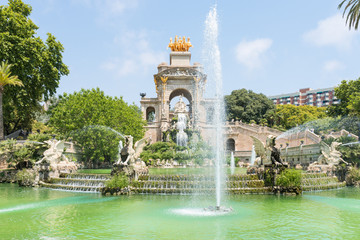 The golden Quadriga on the top of the Font de la Cascada in the Parc de la Ciutadella. The Park, established during the mid-19th, situated in the heart of Barcelona, has a beautiful garden landscape