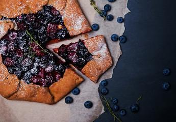 Fototapeta Rustic style crispy pie with blueberries and thyme. Dark toned p obraz
