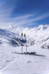 Skis and ski sticks in Alps, Austria