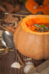 Pumpkin soup on a rustic table