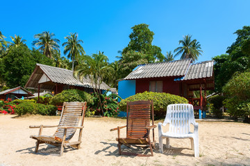 bungalow, chaise lounge on a beach