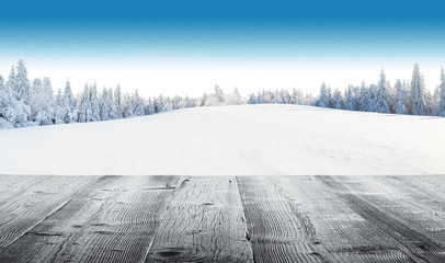 Wall Mural - Winter snowy landscape with wooden planks
