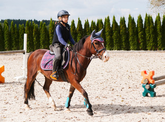 Girl riding on sport pony