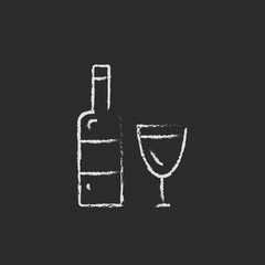 Bottle and a glass icon drawn in chalk.