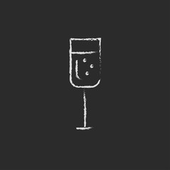 Glass of champagne icon drawn in chalk.