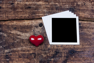 Heart and photo frame on old wooden desk