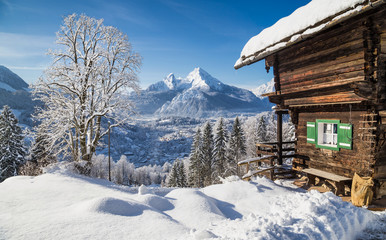 Winter wonderland in the Alps with traditional mountain chalet