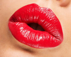 Woman's lips with red lipstick and  kiss gesture