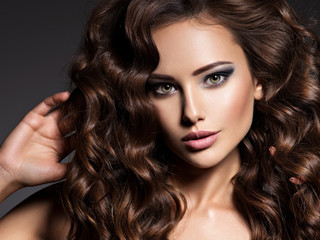 Beautiful woman with long curly hair