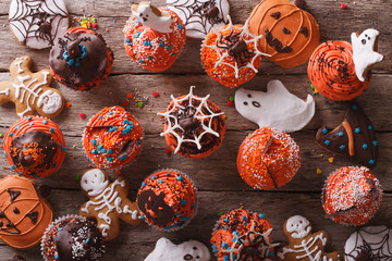 Halloween cupcakes and gingerbread cookies. horizontal top view