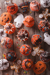 Halloween cupcakes and gingerbread cookies. vertical top view
