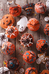 Halloween cupcakes and gingerbread cookies closeup. vertical top view