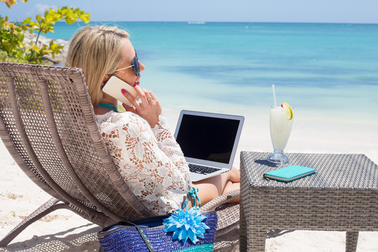 Productive business women on the beach