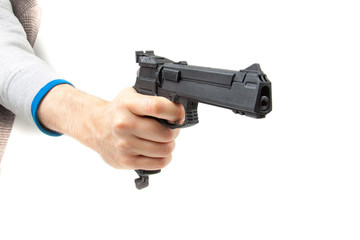 Man's hand holding gun, isolated on white.