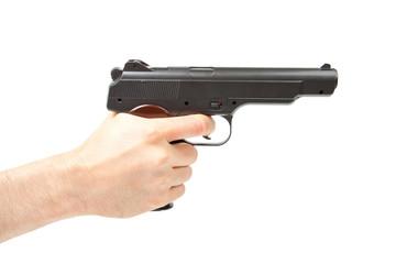 Man's hand holding gun, isolated on white.